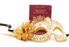 Masquerade mask and British passport royalty free stock images