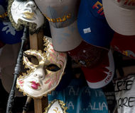 Masquerade mask and caps. Window display of masquerade mask and caps in florence, Italy Stock Images