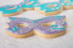 Masquerade Mask Cookies. Shortbread masquerade mask cookies focus in on the centre cookie Stock Image