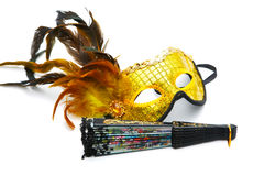 Masquerade  mask and  fan  on a white background Stock Photo
