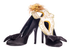 Masquerade mask with high heel shoes Royalty Free Stock Images