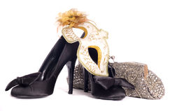 Masquerade mask with high heel shoes and handbag Royalty Free Stock Images