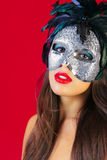 Masquerade mask red background Royalty Free Stock Photos