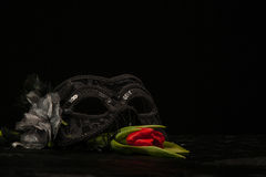 Masquerade Mask With Red Flower On Black Background Royalty Free Stock Photo