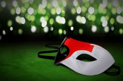 Masquerade masks with blur light. Background royalty free stock photography
