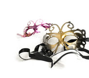 Masquerade Masks. Masquerade carnival masks against a white background. Concept image for traditional New Years Eve party with ribbon and accommodation for copy royalty free stock image