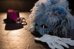 Masquerade masks, gloves and hat. On stage stock photo