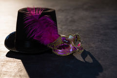 Masquerade masks and hat. On stage royalty free stock photography