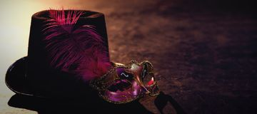 Masquerade masks and hat. On stage royalty free stock images