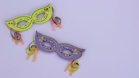 Masquerade masks on a purple background stock photo