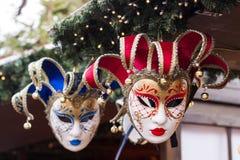 Masquerade masks. Red and blue masquerade masks at Christmas market in London royalty free stock images