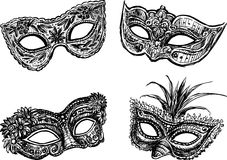 Masquerade masks. Vector drawing of the different carnival masks Royalty Free Stock Photos