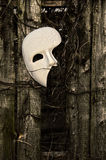 Masquerade - Phantom of the Opera Mask. On Weathered Fence Stock Images