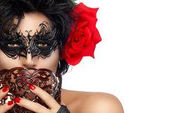 Masquerade. Pretty Short Hair Woman with Elegant Mask. Beauty Model Womans Face Closeup. Pretty Short Hair Gorgeous Woman Wearing Elegant Black Mask and Big Red Royalty Free Stock Photography