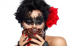 Masquerade. Pretty Short Hair Woman with Elegant Mask Royalty Free Stock Image