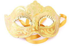 Masquerade theatrical mask. Masquerade female golden theatrical mask isolated on a white background Stock Images