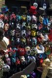 Masques dans la ruelle de brique Photos stock