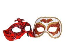 masques italiens d'or carnaval rouges Photos libres de droits