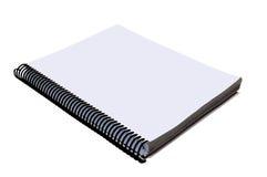 Masquez le carnet de notes à spirale ouvert Photographie stock libre de droits