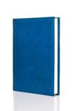 Masquez le livre bleu de livre relié Photos stock