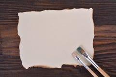 Masquez le papier brûlé bordé Images stock