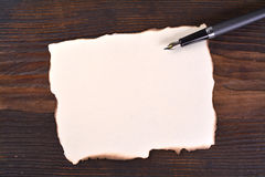 Masquez le papier brûlé bordé Photo libre de droits