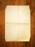 Masquez le papier plié à bord comme fond Photographie stock