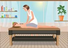 Massösen utför en massage i det soliga rummet Arkivfoton