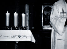 Mass. Catholic Priest and the  altar during  Mass , black and white photo Stock Photos