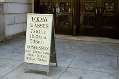 Mass. Today's mass schedule Royalty Free Stock Photo