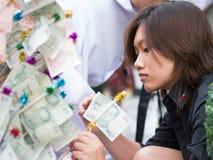 Mass alms giving in Bangkok, Thailand Stock Photos
