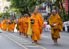 Mass alms giving in Bangkok, Thailand Royalty Free Stock Image
