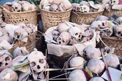 Basket cases. At an ethnic Chinese ceremony in Thailand; after exhuming unmarked and paupers graves from cemeteries, these baskets of skulls are awaiting mass Stock Photos