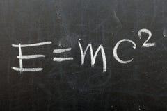 Mass energy equation. Formula e=mc2. Theory of relativity written on school chalkboard royalty free stock photos