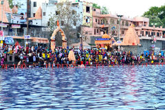 Mass gathering of public bath in kshipra river in great kumbh mela, Ujjain, India Royalty Free Stock Image