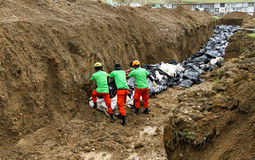 Mass grave for victims of typhoon Haiyan in Philippines Stock Photos