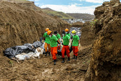 Mass grave for victims of typhoon Haiyan in Philippines. Tacloban City, Philippines- November 17, 2913:A total of 393 cadavers, in black bags, were laid in a stock photos