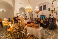 Mass in a Greek orthodox church in island Ios, Greece. Royalty Free Stock Photos