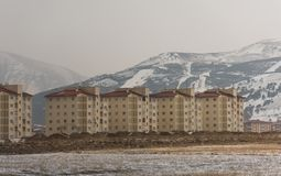 Mass housing residences. Backplane snowy mountains Royalty Free Stock Images