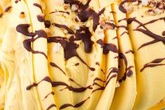 Mass of orange ice-cream with chocolate syrop. royalty free stock image