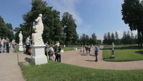 Mass photos near the statue in the park, Tsarskoye Selo Pushkin, Saint Petersburg. Tsarskoye Selo Pushkin timelapse, Saint Petersburg, Russia, Alley in the Park stock video