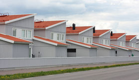 Mass Produced Row House. Identical new build row houses. Symbol for mass production in building industry stock photos