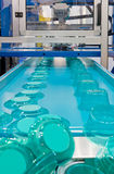 Mass production. Of plastic containers Stock Images