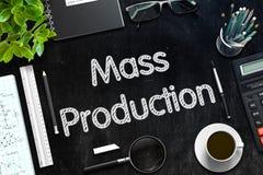 Mass Production on Black Chalkboard. 3D Rendering. Black Chalkboard with Handwritten Business Concept - Mass Production - on Black Office Desk and Other Office royalty free illustration