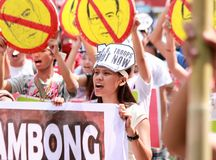 Mass protest greeted US President Barack Obama in Philippines. Woman protesters chanting slogans against the US government. Thousands joined the mass protest as Royalty Free Stock Image