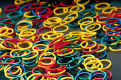 Mass of red, blue, yellow and green elastic bands. Royalty Free Stock Photography