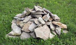 A mass of rocks on the green grass Stock Photography