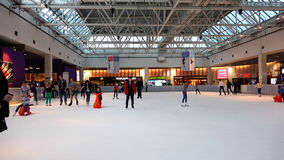 Mass skating of people on an indoor rink in a shopping complex stock video footage
