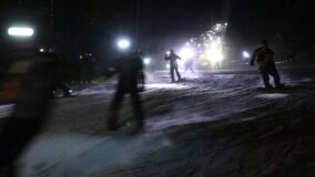 Mass skiing and snowboarding with flashlights