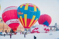 Mass-start on the festival of hot air ballons. NIZHNY NOVGOROD, RUSSIA - FEBRUARY 24, 2018. Mass-start on the festival of hot air ballons Royalty Free Stock Images
